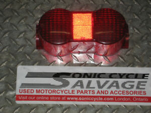 1976 suzuki  gt - 750 tail light lens brand new oem