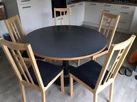 IKEA round family dining room kitchen table with 5 wooden black cushion chairs