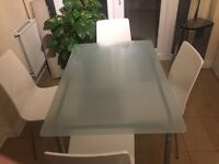IKEA glass kitchen table with four John Lewis chairs