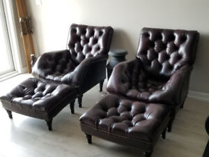 Two incredible leather chairs and ottomans