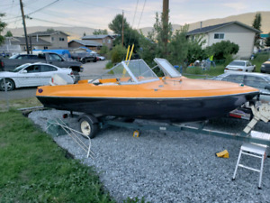 1975 glasstron 16.5 foot  closed bow boat.  85 hp evinrude.