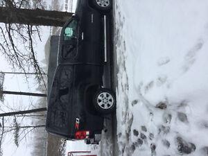 """GMC Sierra 5'6"""" raider high truck cap."""