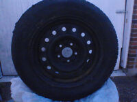 4 winter black rims in great cond, tires no good