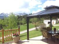 Mountain view acreage bordered by crown land in Crowsnest Pass