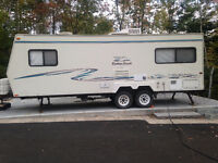 Great Travel trailer lifted for additional ground clearance.