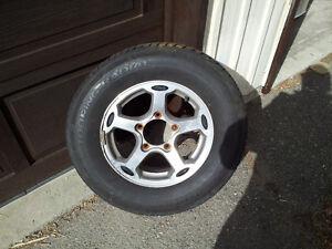 4 pneus avec mag de Tracker