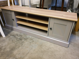 A new good quality grey x oak effect 2 door 2 shelve tv unit.