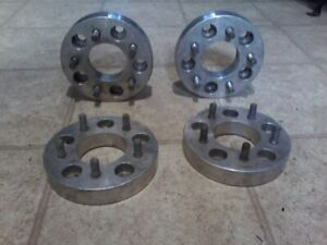 SET OF FOUR 1 1/4 WHEEL ADAPTERS