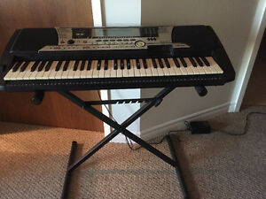 Keyboard, stand, pedal, mike, dust cover, carrying case & amplif