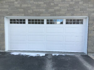 Insulated steel garage door 16 x 7