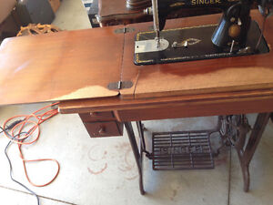 2 antique treadle sewing machines