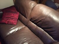 Brown leather couch and matching chair - very good condition