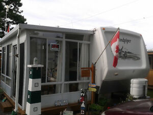 30 Ft. Sandpiper Trailer with Two Slide Outs & Attached Sun Room