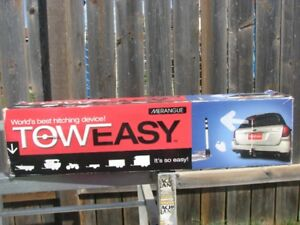 tow easy hitching device  never used