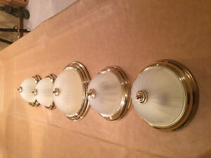 5 gold coloured ceiling lights. 4-11.25 inches, 1-15 inch.