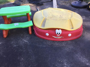 Little Tikes sand box and Winnie the Pooh picnic table