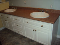 3 bathroom countertops with 2 sinks and 2 faucets