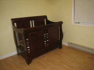 Beautiful Hardwood Crib converts to toddler sleigh bed