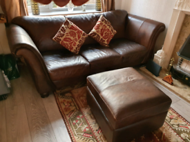 Two brown 3 seater leather sofas and a foot stool