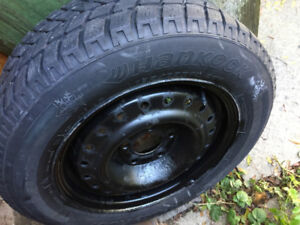 Hankook 4 Used winter tires with rim
