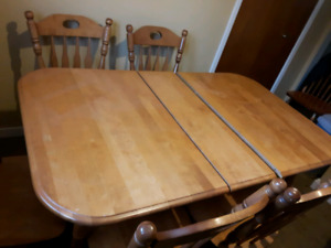 solid wood table and four chairs
