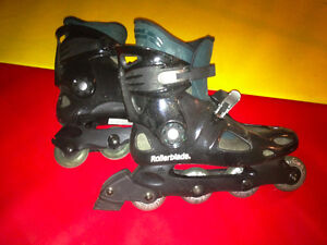 ROLLER BLADES - TWO PAIRS