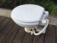 "12 volt ""Osculate"" macerator boat toilet."