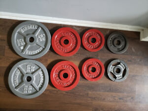 160 lbs of Olympic Weight Plates for 75 cents a pound