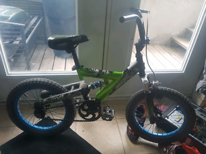 Dual suspension bicycle for age 4 to 8.