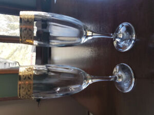 Never used Excellent Condition Gold Etching Champagne Glasses