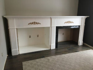 Beautiful gas fireplace with 9 foot surround