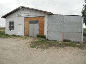 Lge lot w/ warehouse , storage , garage space in Neepawa
