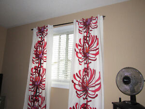 Window curtains, Ladies coats and an assortment of cushions