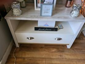 Unit with storage drawer