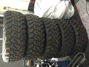 5 Brand new 35x12.5x17 deep digger with jeep rims