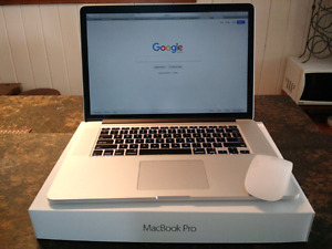 MacBook Pro 15-inch virtually new $2200