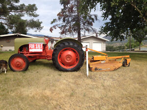 Ford tractor and woods 4 ft mower