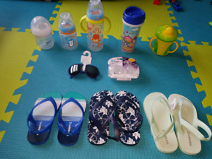 Baby bottles, activity mat, sunglasses, soothers, toddler flip f