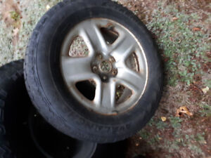Toyota  rav4 winter tires and trims 300 firm.