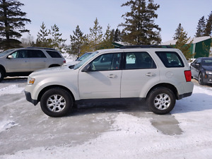 2008 Mazda Tribute ES. 4 CYL. 5 SPD. MANUAL TRANS  $3,900