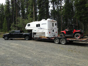 Truck with Camper mounted on Gooseneck Trailor