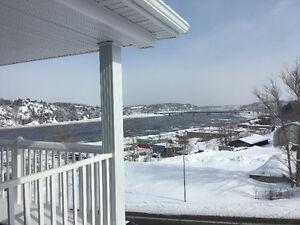 Condo haut de gamme.vue imprenable sur le Saguenay