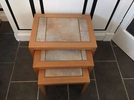 Solid oak and tiled top nest of tables