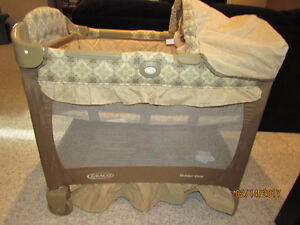 Graco travel crib with stages