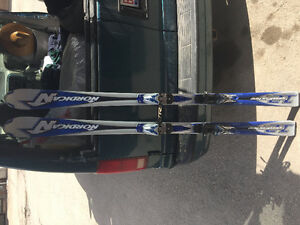 "170 Nordica skis and a set of 54""/135cm poles"