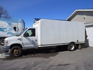 2011 Ford E-450 Super Duty CTV with tailgate lift.