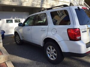 2008 Mazda Tribute (with winter tires and rims)