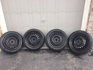 235 55R 17 Michelin X-Ice Winter Tires Set of 4 on Rims