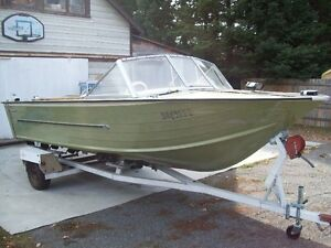 18 foot Starcraft 120 hp inboard/outboard