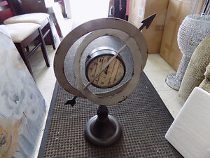 Clock Sphere Shape $ 109.00 Call 727-5344